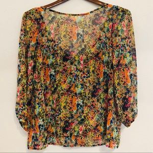 Multi-Color blouse with bow detail in back: Size M